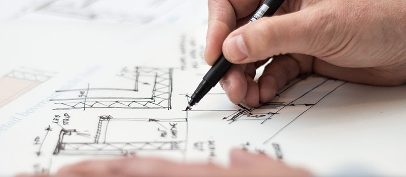 An Architect Drawing a Floor Plan of Real Estate