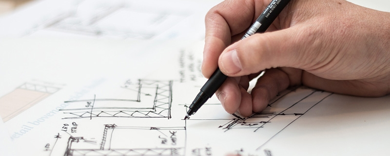 An Architect Drawing a Floor Layout of Real Estate