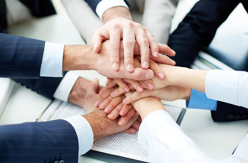 A Group Handshake of a Project Team
